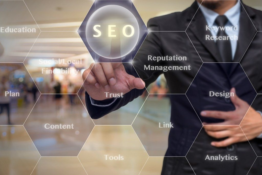 Businessman clicking on SEO