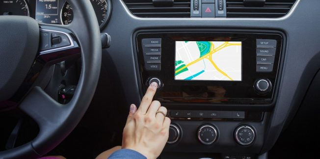 A driver navigating using a GPS device