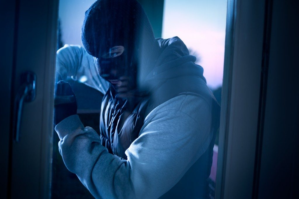 a burglar invading a house