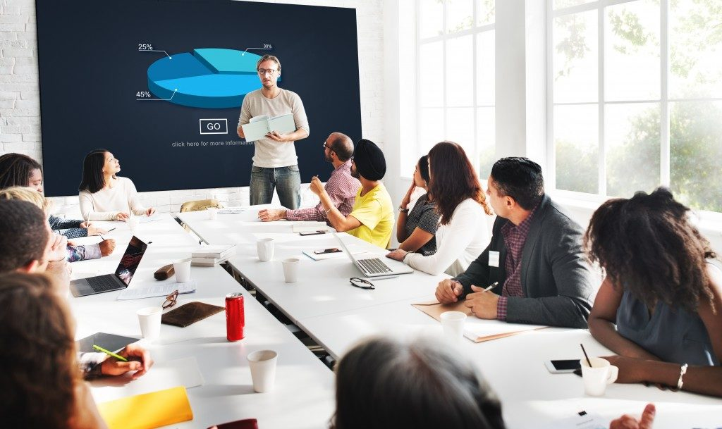 man presenting at team meeting