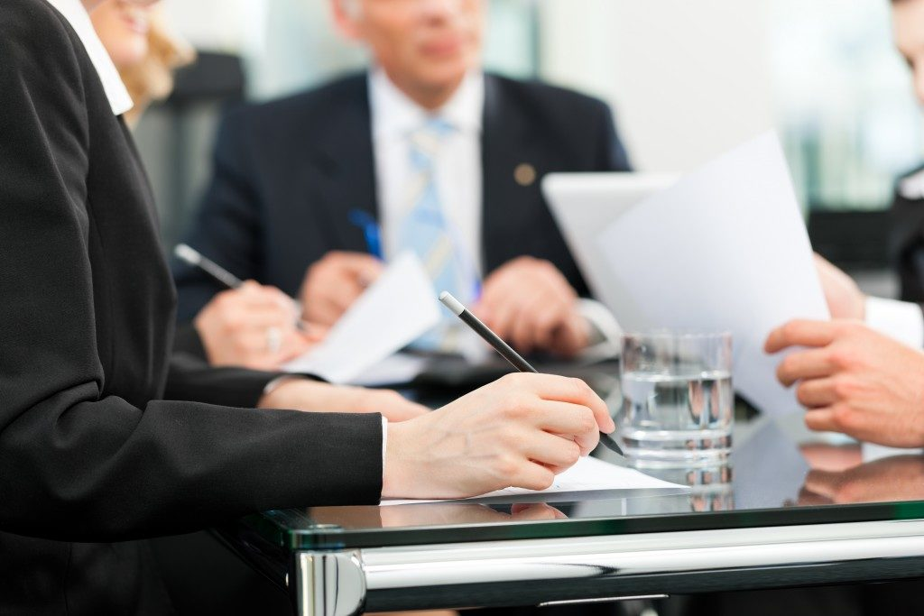 Business meeting in an office, lawyers or attorneys discussing a document or contract agreement