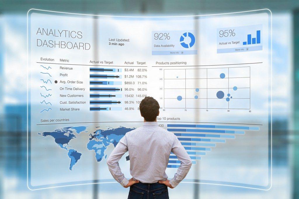 man looking at global data
